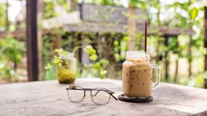 iced coffee and glasses on a wooden table.