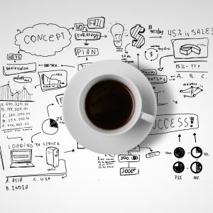 coffee cup and business strategy on a white background