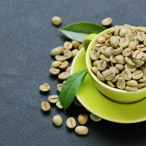 natural organic green coffee beans on a black background