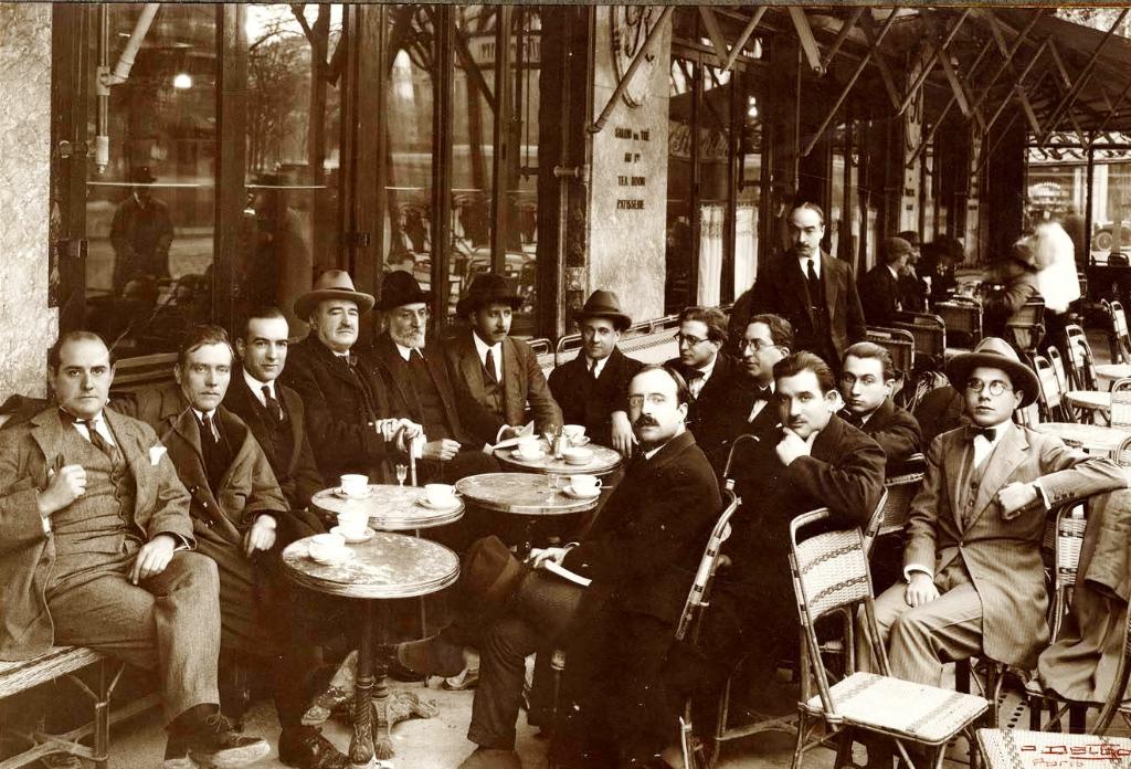 Imagen de época donde se ven reunidos grandes maestros literarios de finales del siglo XVIII y principios del XIX en una de sus tertulias en un famoso café parisino de la época.